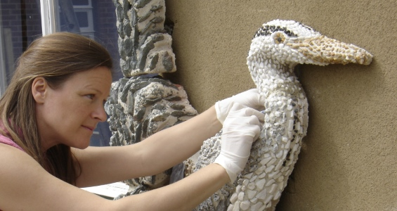 Artist Sarah Rintoul installing a commission